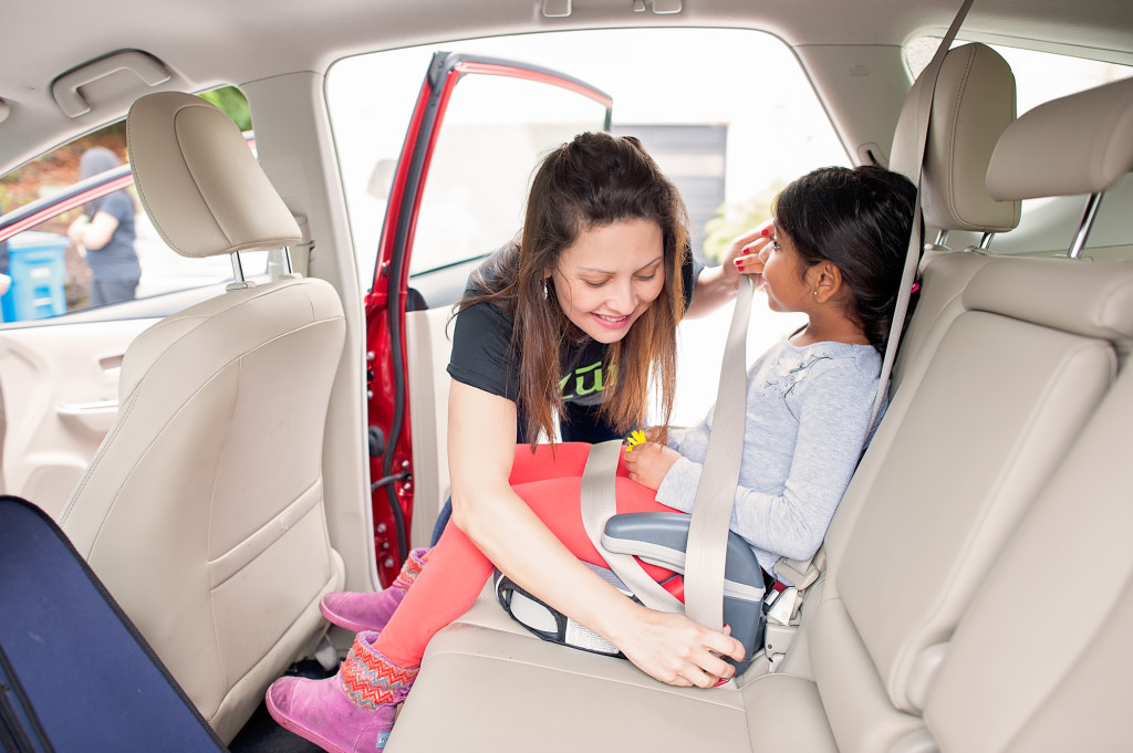 Rideshare - Zum ensures kids are buckled up